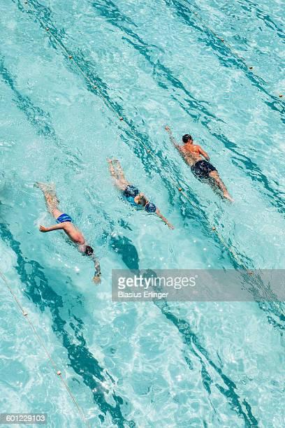 People swim in ocean pool