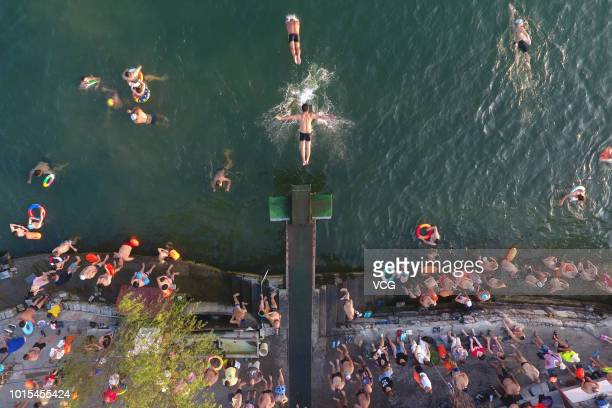 People swim in the Han River to cool off as a heat wave hits the area on August 7 2018 in Xiangyang Hubei Province of China