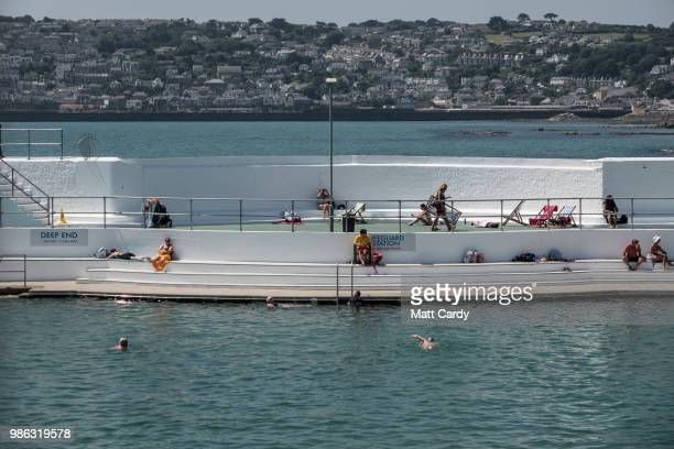 People swim in the outdoor Jubilee Pool in Penzance on June 28, 2018 in Cornwall, England. Parts of the UK are continuing to experience heatwave...