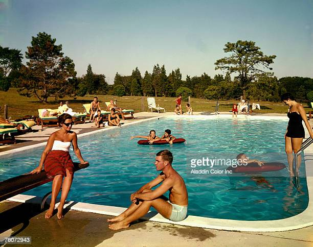 People swim in the outdoor swimming pool at the Tocker Mill Inn, Southampton, New York, 1960s.