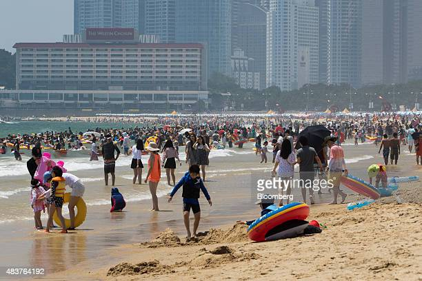 People swim in the sea at Haeundae beach in Busan South Korea on Friday July 31 2015 South Korea urged its people to put the outbreak of Middle East...