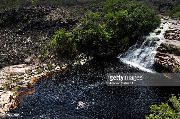 People Swimming at waterfall. Brazil