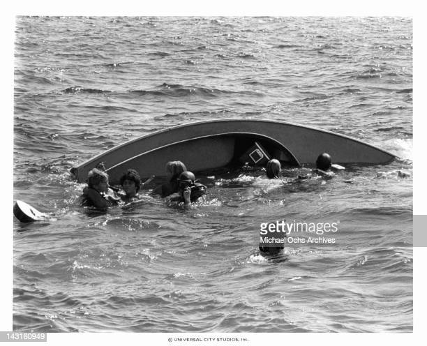 People swimming from capsized boat in a scene from the film 'Jaws 2', 1978.