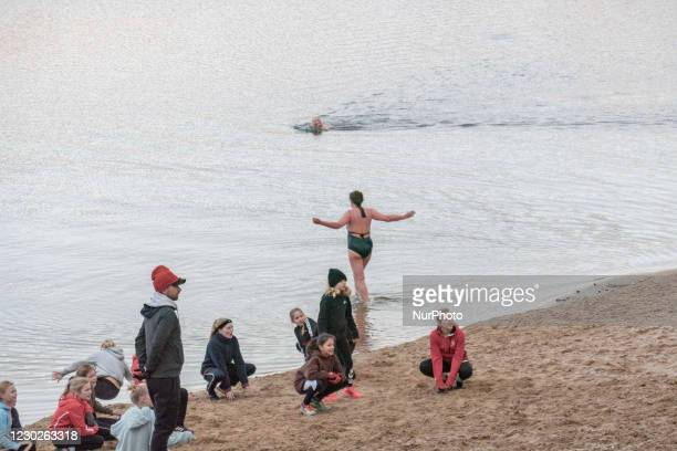 People swimming in cold winter conditions in a lake in Nationaal Park Zuid-Kennemerland is a Dutch National Park between Bloemendaal and the North...