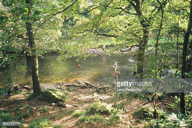 People swimming in local river in Wales