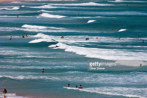People swimming in ocean at Cronulla Beach, Sutherland Shire.