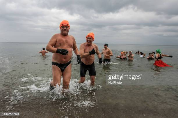 People swimming in the cold Baltic Sea waters are seen on 1 January 2018 in Gdynia Poland Members of Gdynia Walrus Club take part in the annual New...