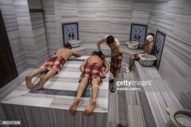 People take a bath at a hammam of a facility located in Haymana district of Ankara Turkey on December 28 2017 Haymana a district famous for its...