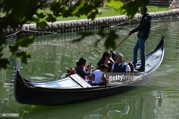 People take a canoe ride on the Porsuk River in Eskisehir Turkey on August 31 2017