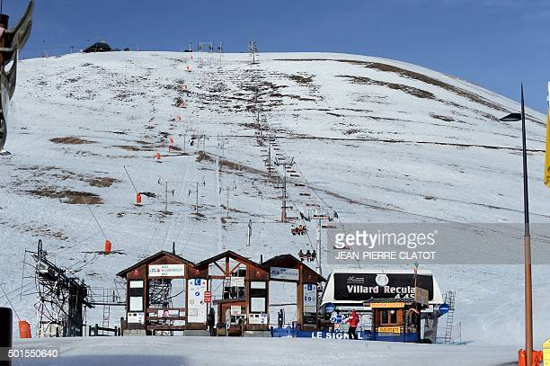 People take a chairlift at the Alpe d'Huez ski resort on December 16 a few weeks before the opening day of the resort for this year's ski season /...