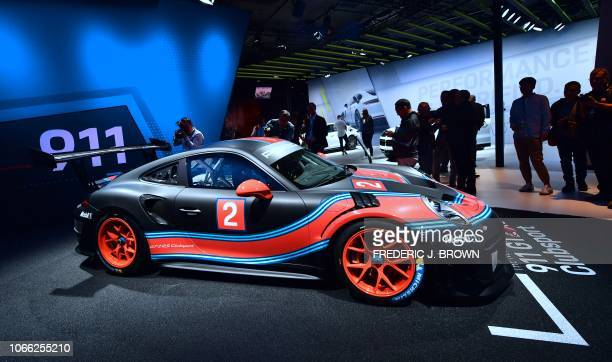 People take a closer look at the new Porsche 911 GT2 RS Clubsport on display at AutoMobility LA the trade show ahead of the LA Auto Show November 28...