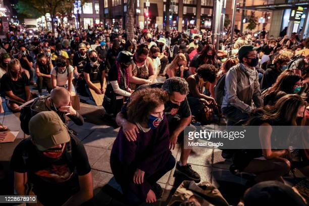 People take a knee on the 16th Street Mall as they protest the grand jury decision in the Breonna Taylor case on September 23 2020 in Denver United...