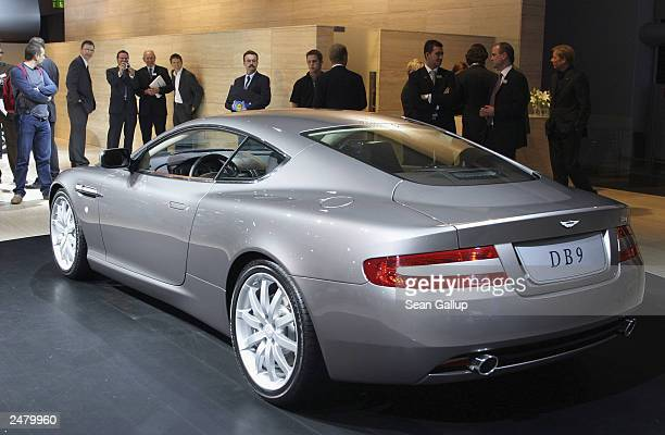 People take a look at the new Aston Martin DB9 sports car at the Frankfurt Auto Show September 10 2003 in Frankfurt Germany The show is open to the...