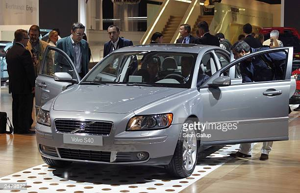 People take a look at the new Volvo S40 sedan at the Frankfurt Auto Show September 10 2003 in Frankfurt Germany The show is open to the public from...