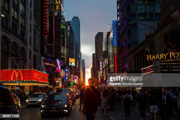 People take a look at the phenomenon known as Manhattanhenge on 42nd Street on May 30 2018 in New York City Manhattanhenge or the Manhattan Solstice...