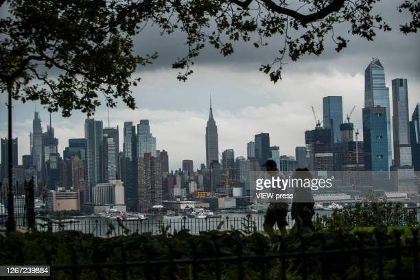 People take a look of the New York Skyline and the Empire State Building on August 19, 2020 in Weehawken, New Jersey. Exodus out of New York has...
