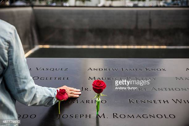People take a moment of silence to remember loved ones during an anniversary ceremony commemorating the terrorist attacks of September 11, 2001 on...