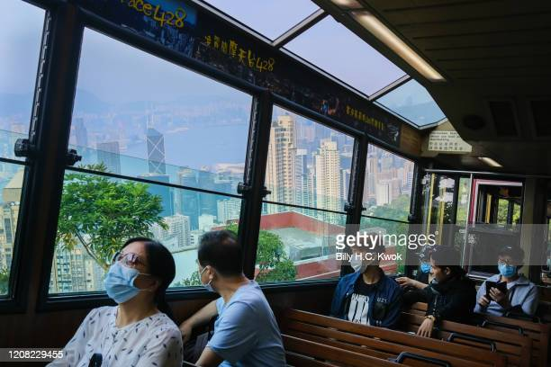 People take a peak tram during a coronavirus outbreak on March 26 2020 in Hong Kong China Latest statistics showed Hong Kong tourist arrivals plunge...