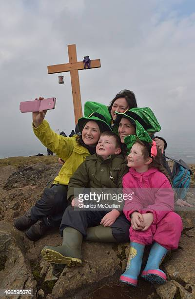 People take a selfie as hundreds of people make the St. Patrick's Day pilgrimage to the top of Slemish on March 17, 2015 in Ballymena, Northern...