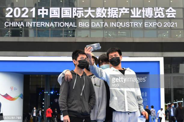 People take a selfie during China International Big Data Industry Expo at Guiyang International Conference and Exhibition Center on May 26, 2021 in...