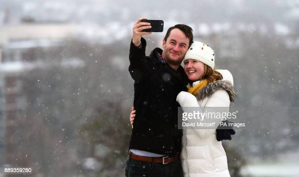 People take a selfie in the snow on Primrose Hill in London as heavy snowfall across parts of the UK is causing widespread disruption closing roads...