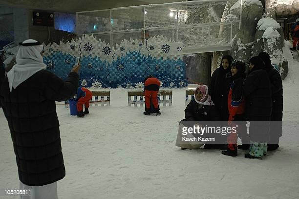 People take a souvenir photo while enjoying an indoor ski resort Dubai United Arab Emirates December 4th 2005 Ski Dubai is an indoor ski resort with...