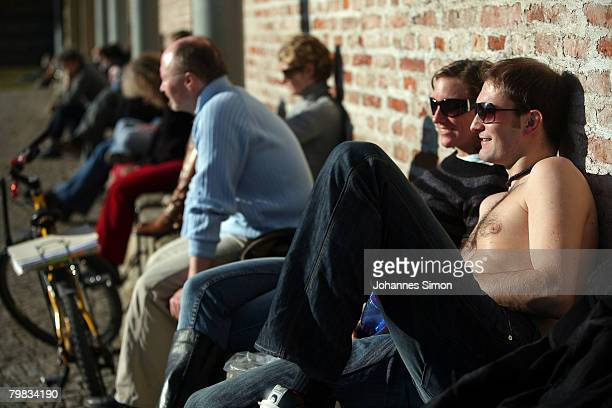 People take a sun bath in front of Alte Pinakothek museum on February 19 2008 in Munich Germany Germany experiences currently an unusually warm...