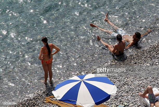 People take a sun bath on the beach during the summer holidays on August 22 2012 in Nice southeastern France AFP PHOTO / VALERY HACHE