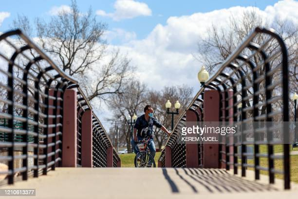 People take advantage of a warm spring day to spend time outdoors amid the coronavirus COVID19 pandemic on April 20 at the Falls Park in Sioux Falls...