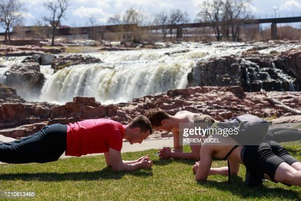 People take advantage of a warm spring day to spend time outdoors amid the coronavirus COVID19 pandemic on April 20 at Falls Park in Sioux Falls...