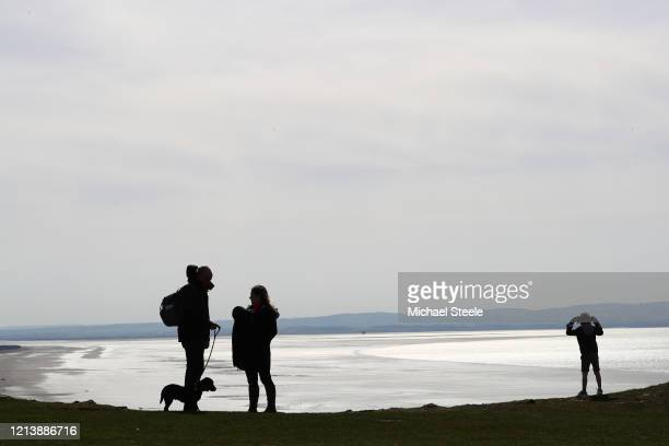 People take advantage of the sunshine and mild temperatures on March 21, 2020 in Brean on Sands, England. Coronavirus has spread to at least 182...
