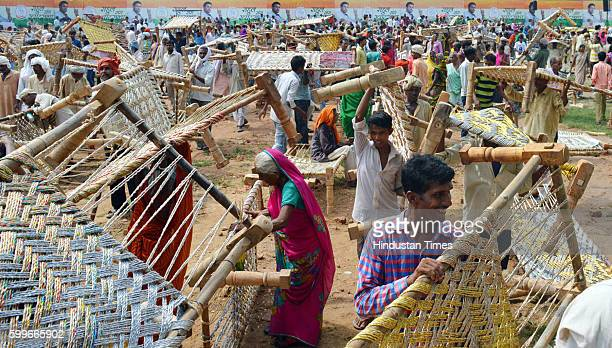 People take along cots after Congress Vice President Rahul Gandhi's 'Khat pe charcha' programme as part of his Kisan Yatra for the upcoming UP polls...