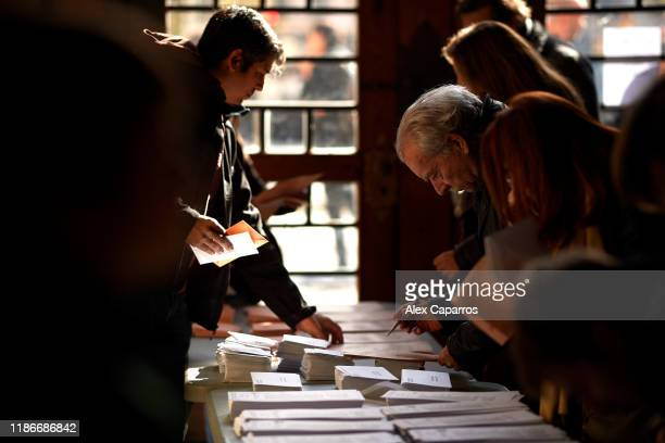 People take ballots for casting their vote at a polling station on November 10 2019 in Barcelona Spain Spain holds its fourth general election in...