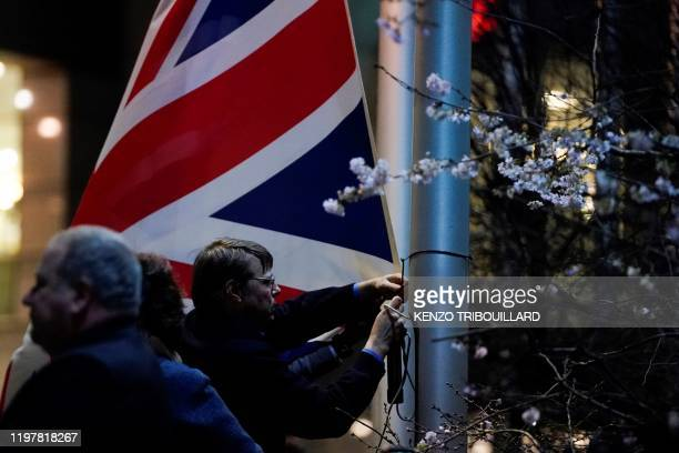 People take down the United Kingdom's flag from outside the European Union Parliament in Brusselson Brexit Day January 31 2020 Britain leaves the...