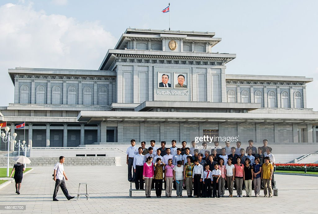 People take group a picture in front of the tomb of Kim Kim Il Sung and Kim Jong Il at Kumsusan Palace of the Sun on August 23, 2015 in Pyongyang, North Korea. North and South Korea today came to an agreement to ease tensions following an exchange of artillery fire at the demilitarized border last week.