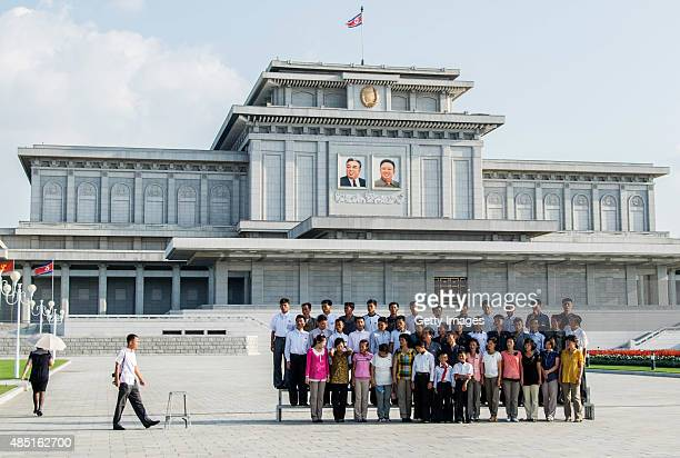 People take group a picture in front of the tomb of Kim Kim Il Sung and Kim Jong Il at Kumsusan Palace of the Sun on August 23 2015 in Pyongyang...