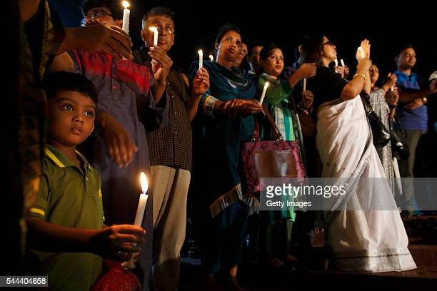 People take part a candlelight vigil organised by Sammilito Sangskritik Jote an organisation of cultural activists at Central Shaheed Minar to...