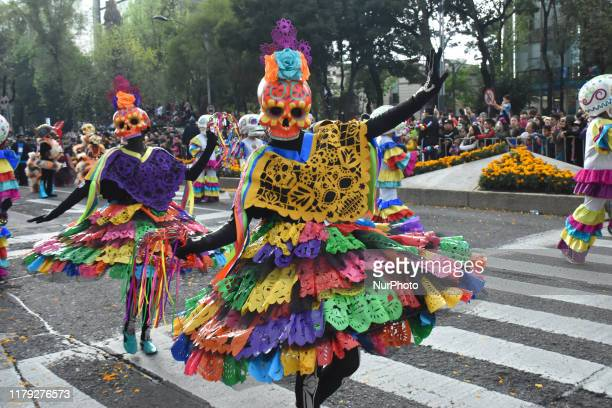 People take part at annual 'Dia de Muertos Parade' as part of the celebrations of Mexico's Dia de Muertos at Angel of Independence on October 28 2019...