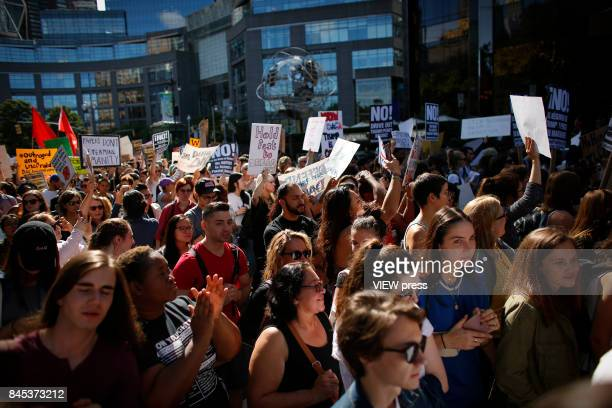 People take part during a march in protest of President Trump's decision on DACA in front of a Trump Hotel on September 9 2017 in New York City