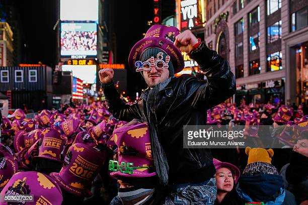 People take part during New Year's Eve celebrations on December 31 2015 in New York City At least 6000 police officers have been deployed in one of...