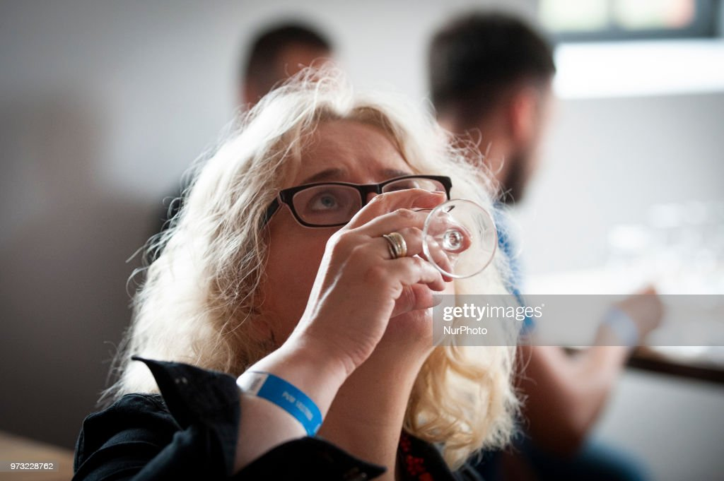 People take part in a a tasting of vodka's at the opening of the Polish Vodka Musuem on June 12, 2018 in Warsaw, Poland.
