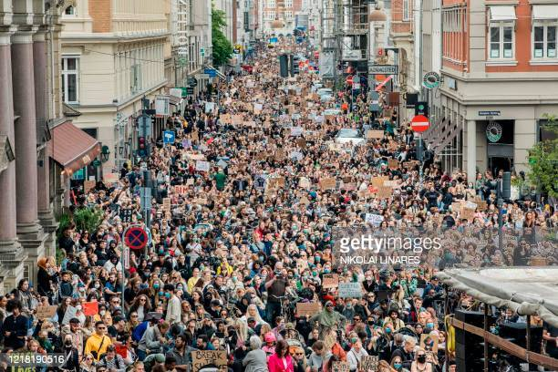 People take part in a Black Lives Matter demonstration in Copenhagen Denmark on June 7 in the wake of the killing of George Floyd an unarmed black...