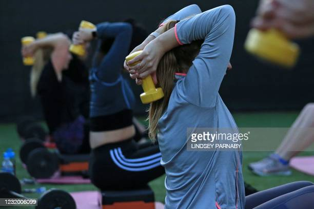 People take part in a Body Sculpt class, using weights at SJ's Gym in Scunthorpe, north east England on March 29 as England's third Covid-19 lockdown...