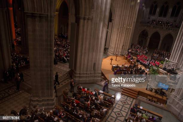 People take part in a candle light vigil at the Washington National Cathedral ahead of Saturday's March For Our Lives rally March 23 2018 in...