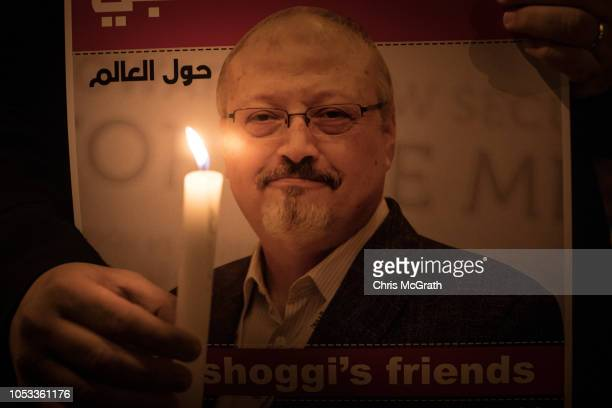 People take part in a candle light vigil to remember journalist Jamal Khashoggi outside the Saudi Arabia consulate on October 25 2018 in Istanbul...