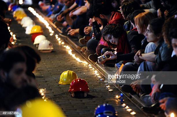 People take part in a candlelight vigil as part of a demonstration in honour of the victims of the mining accident in Soma, on May 16 at Kadikoy, in...