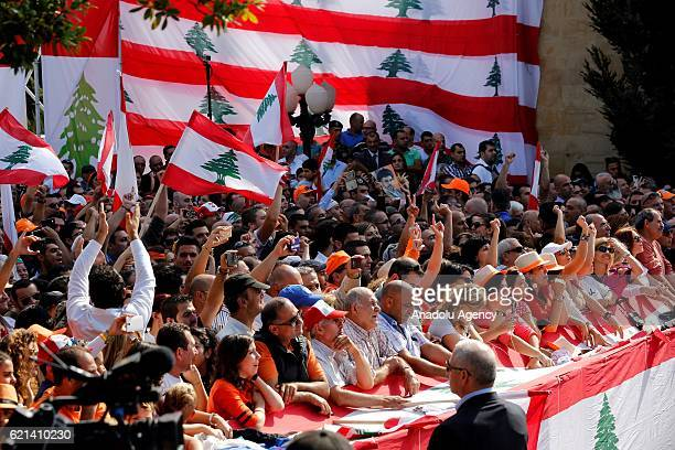People take part in a celebration after Michel Aoun elected as a President during the Parliamentary session at at Baabda Palace in Beirut Lebanon on...