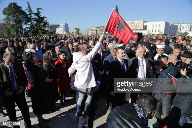 People take part in a ceremony held for National Albanian Flag Day and the anniversary of Albania's Independence at Skanderbeg Square in Tiran...