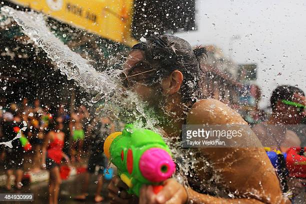 People take part in a citywide water fight during the Songkran water festival on April 15 2014 in Chiang Mai Thailand The Songkran festival marking...