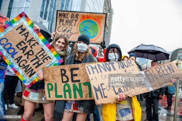 People take part in a climate demonstration in Brussels Belgium on January 27 2019
